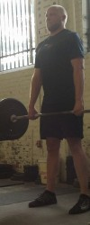 Posing while deadlifting.